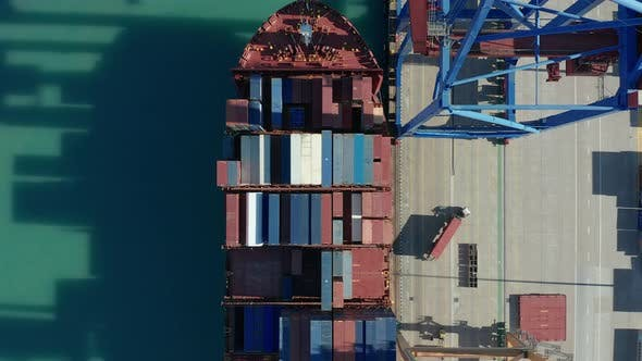 Aerial View. Container Ship Loading and Unloading in Deep Sea Port.
