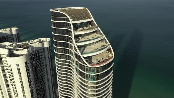 Aerial video modern highrise tower on the beach Miami FL USA