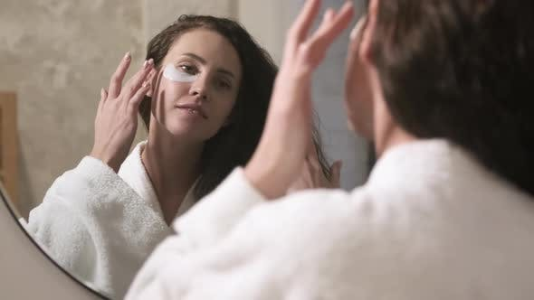 Thumbnail for Woman Applying Under-Eye Patches in Bathroom