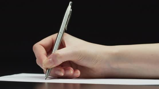 Hand writing on a paper
