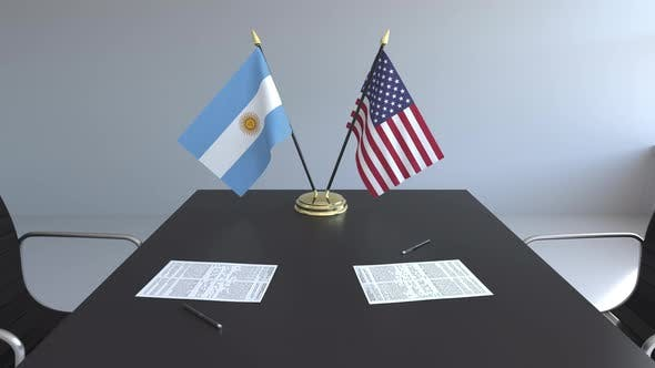 Flags of Argentina and the United States on the Table