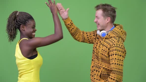 Thumbnail for Young Multi-ethnic Couple Giving High-five Together