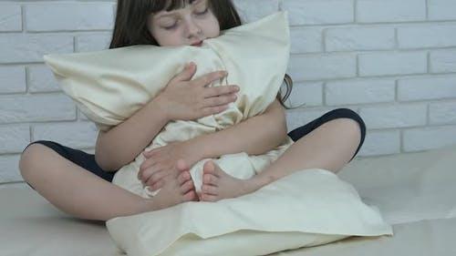 Embracing the Pillow.