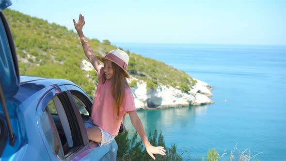 Thumbnail for Little Girl on Vacation Travel By Car Background Beautiful Landscape