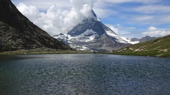 Time lapse of snowy Matterhorn peak and lake Stellisee, Swiss Alps