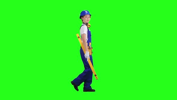 Thumbnail for Girl Is Wearing a Yellow Building Level, Green Screen