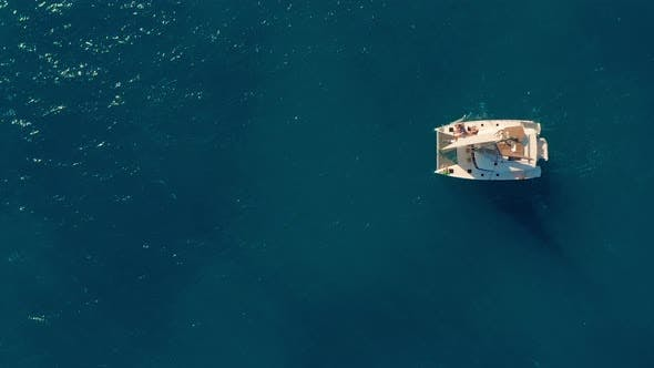 Catamaran Sailing on the Sea. Aerial Shoot of the Catamaran Sailing in the Wind.
