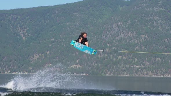 Thumbnail for Young man wake boarding on a lake.