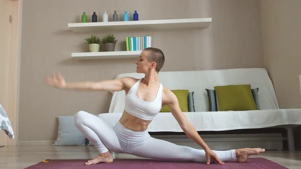 Attractive Lady Doing Yoga Exercises at Home