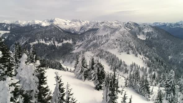 Thumbnail for Artistic Floating Aerial Of Backcountry Snowy Mountains