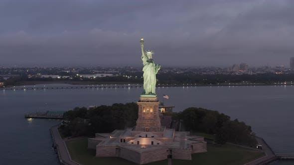 Circling Statue of Liberty Beautifully Illuminated in Early Morning Light New York City