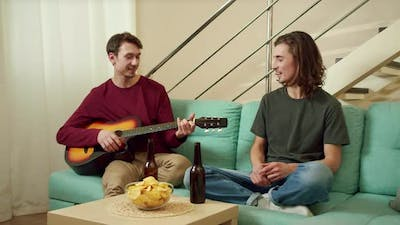 Friends are Playing Guitar and Having a Good Time