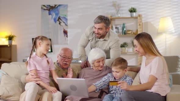 Thumbnail for Extended Family Shopping Online on Laptop