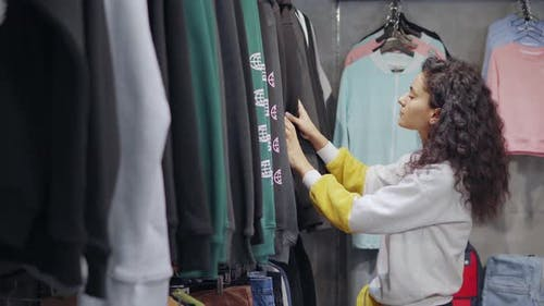 Woman Trying To Find New Sweatshirt