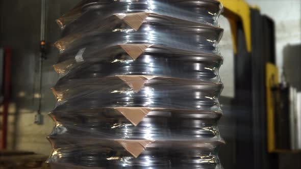 Thumbnail for Packing Wooden Pallet Loaded By Made Stamped Steel Discs in Polyethylene Tape.