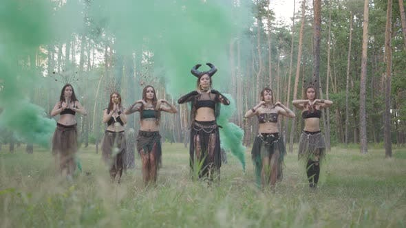 Thumbnail for Group of Women Dancers with Make-up and in Mystical Fabulous Costumes Dancing in Color Smoke. Forest