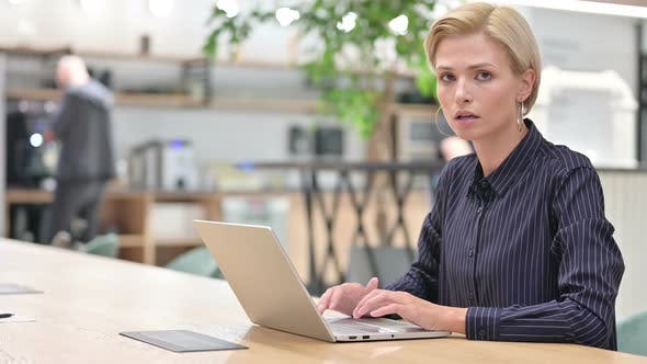 Thumbnail for Serious Young Businesswoman with Laptop Saying No By Head Shake