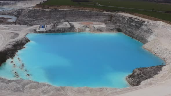 Thumbnail for Drone Flight Over Limestone Quarry Pool