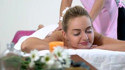 Woman Gets Back Massage Spa By Massage Therapist