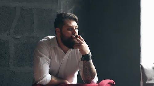 Young Smoker Man Relaxing