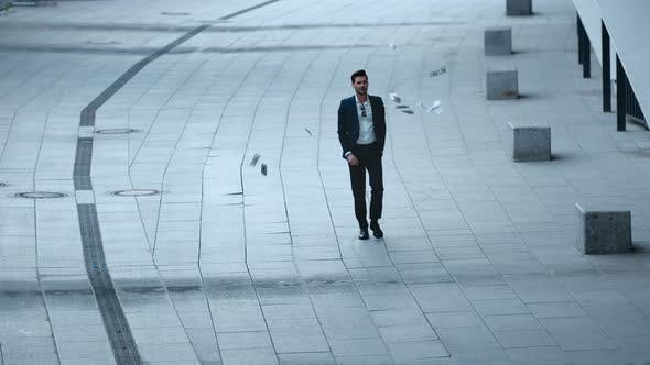 Thumbnail for Confident Businessman Throwing Money at Street. Businessman Walking at City.