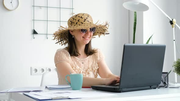 Female Employee Dreaming of Vacation in Office