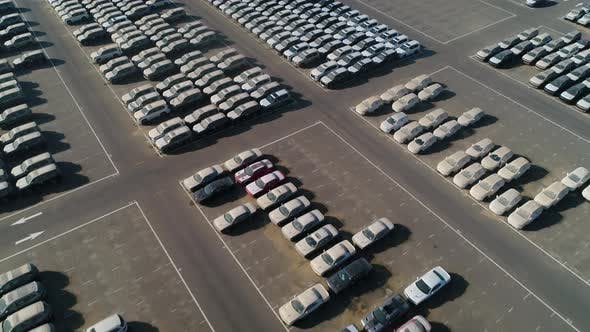 Thumbnail for Aerial view of group of cars at parking space on a desert landscape, U.A.E.