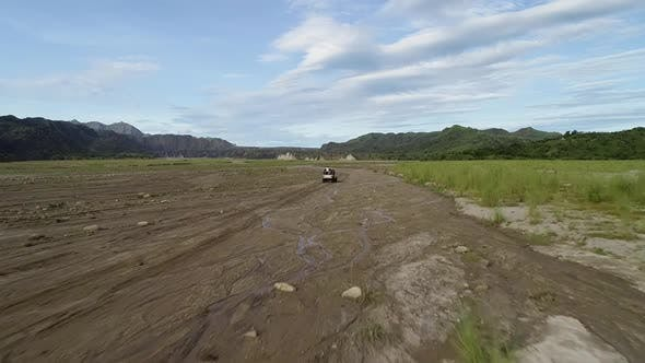 Thumbnail for Aerial view following off road jeep in the valley on Tarlac, Philippines.