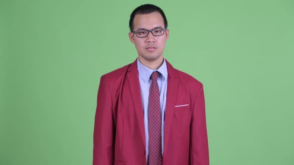 Thumbnail for Happy Asian Businessman with Eyeglasses Getting Good News