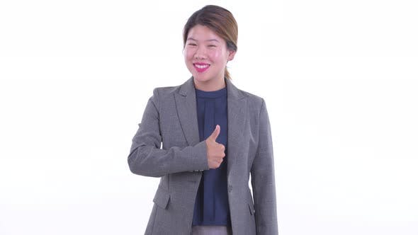 Thumbnail for Happy Young Asian Businesswoman Giving Thumbs Up