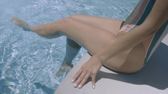 Thumbnail for Legs In The Pool