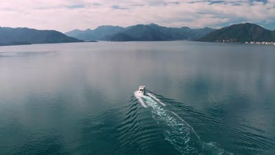 Yacht Sailing Near the Rocky Coast in Turkey