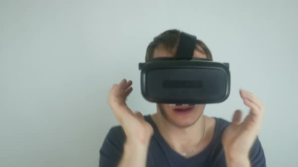 Thumbnail for Man In The Helmet Of Virtual Reality Sings And Dances