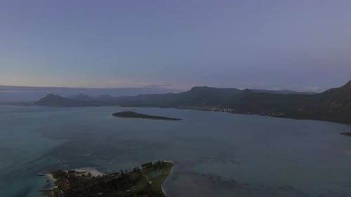 Aerial panoramic view of ocean and Mauritius coastline with mountains