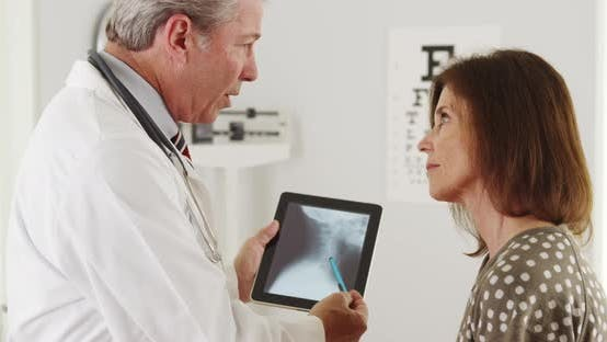 Thumbnail for Doctor explaining xrays to elderly patient