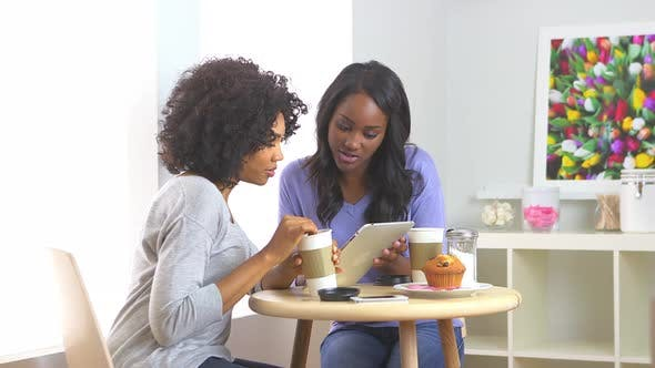 Thumbnail for African American friends using tablet in caf_