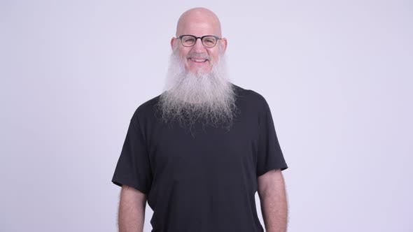 Thumbnail for Happy Mature Bald Bearded Man with Eyeglasses Smiling