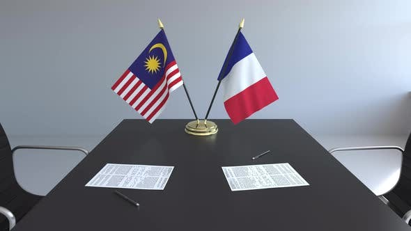 Flags of Malaysia and France on the Table