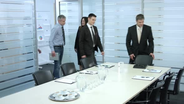 Secretary Comes in a Meeting Room