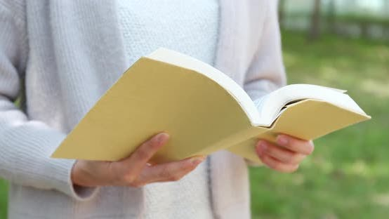 Thumbnail for Reading book at outdoor