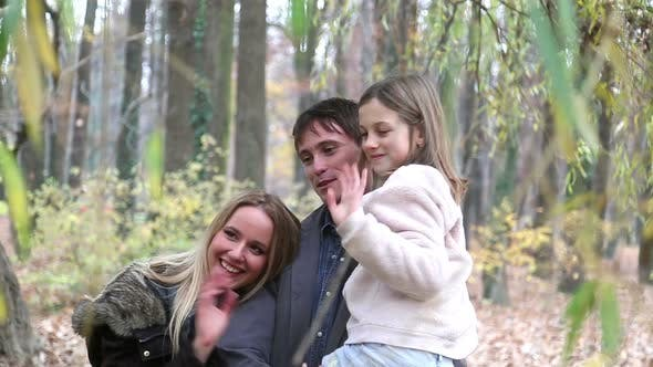Thumbnail for Portrait of beautiful young family waving