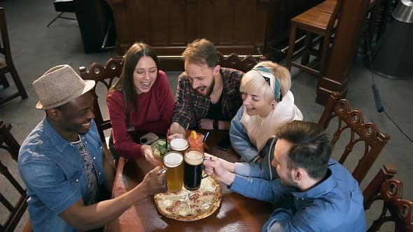 Thumbnail for Company of Young Hipster Friends Clinking Glasses with Beer