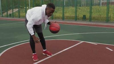 Black Man Dribbling Basketball Outside