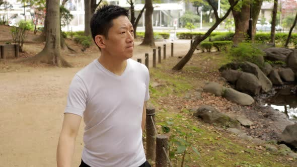 Thumbnail for Middle-aged Japanese man exercises in Tokyo Japan