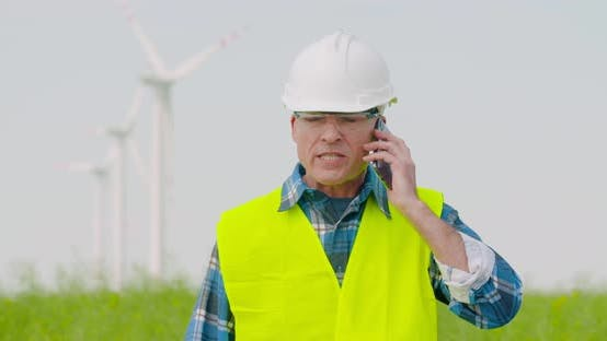 Thumbnail for Frustrated Male Engineer Talking On Phone At Farm