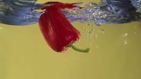 Thumbnail for Paprika Splashing Into Water in Slowmotion