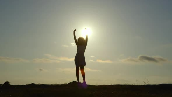 Thumbnail for Silhouette of woman against sky