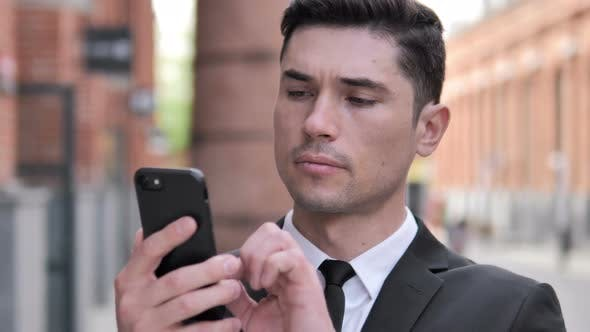 Cover Image for Outdoor Businessman Using Smartphone, Typing Message