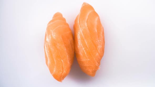 Thumbnail for Top View of Spinning Two Salmon Sushi