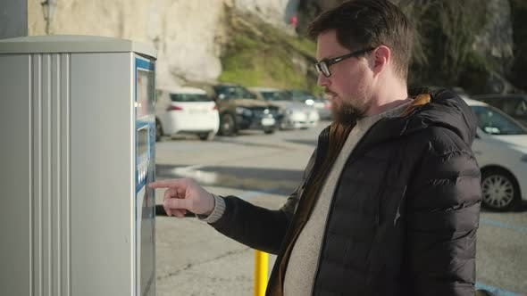 Thumbnail for Man Is Using Parking Meter, Pressing Buttons